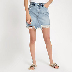Mini-jupe en jean déchiré à délavage bleu clair