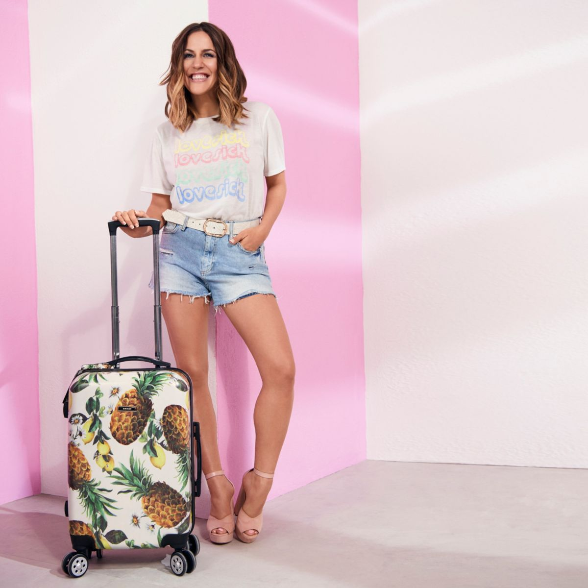 Cream Caroline Flack four wheel suitcase