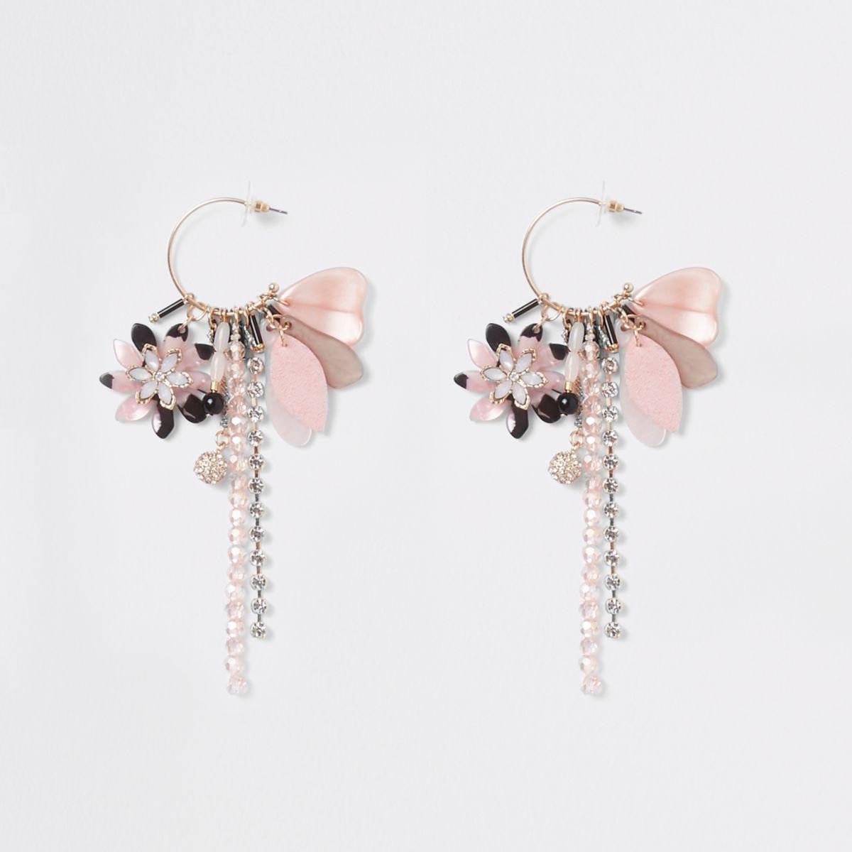 Gold tone hoop pink charm drop earrings