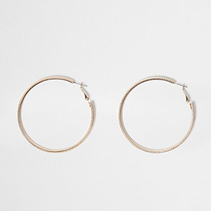 Gold tone faceted hoop earrings