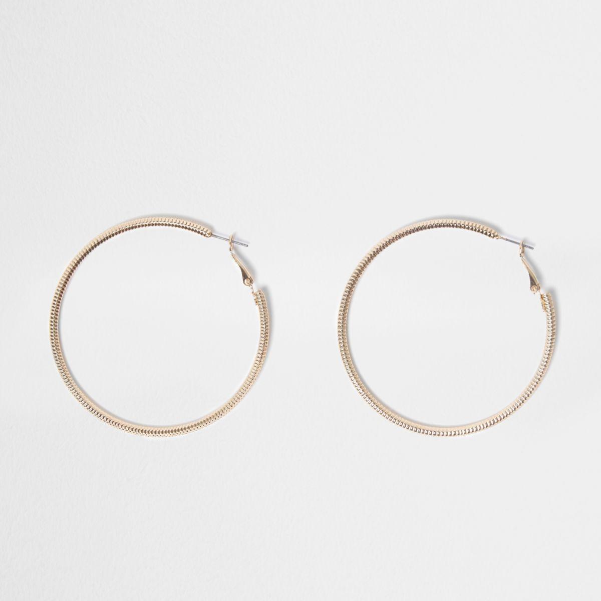 Gold tone faceted hoop earrings