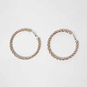 Goudkleurige oorringen van glinsterend touw