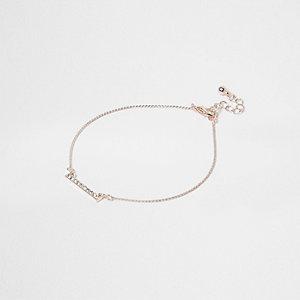 Bracelet de cheville façon or rose avec barre à strass