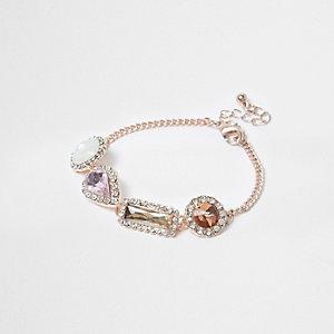 Roze goudkleurige armband bedekt met siersteentjes