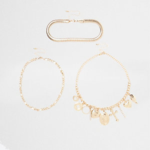 Gold tone charm layer necklace set