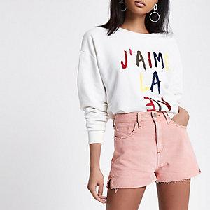 Mini short en jean orange clair avec ourlet brut
