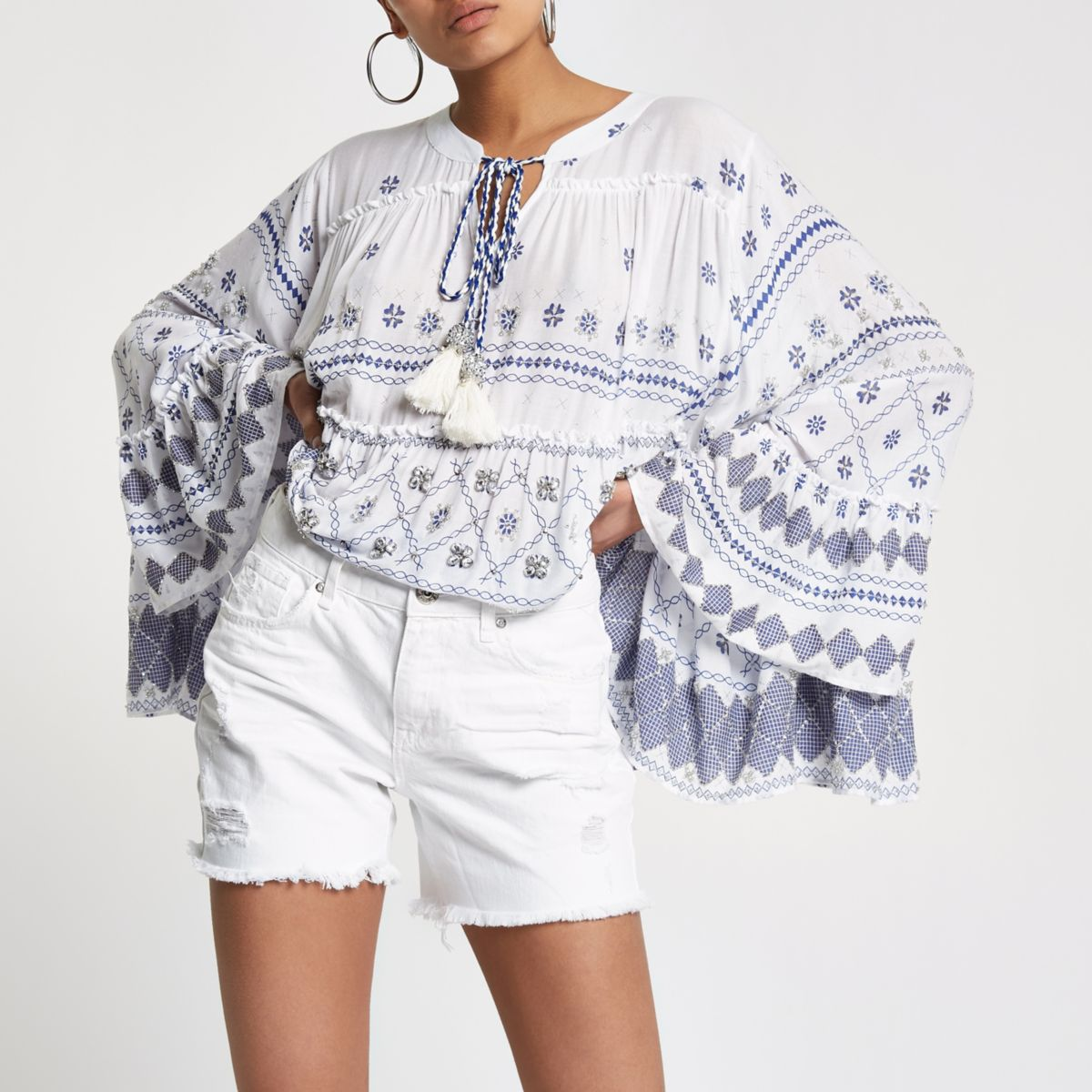 ​White denim ripped boyfriend shorts