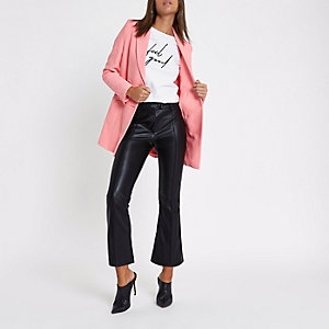 Black faux leather kick flare trousers