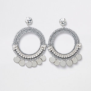 Silver tone metallic hoop disc earring