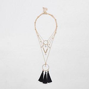 Gold tone black triple tassel necklace