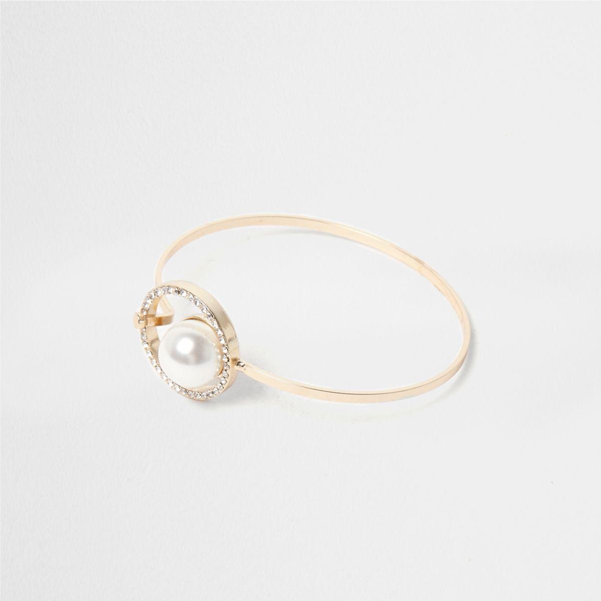 Gold tone pearl hoop latch bracelet