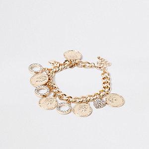 Goudkleurige schakelarmband met muntjes en cirkels