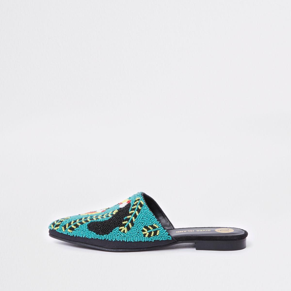 Blauwe loafers zonder achterkant met toekanprint en kraaltjes