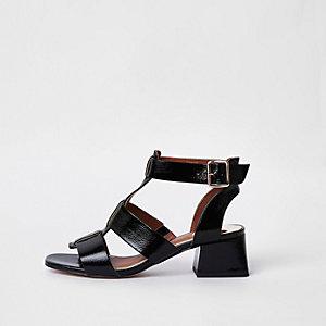 Sandales noires effet cage à talon carré