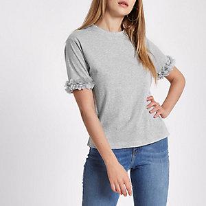T-shirt gris chiné à fleurs aux manches