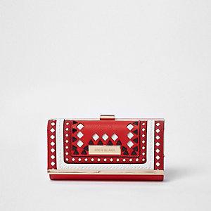 Rode portemonnee met druksluiting, uitsnedes en diamantjes