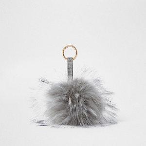 Porte-clés à gros pompon en fausse fourrure gris