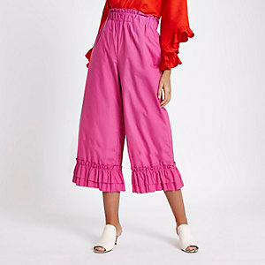 Jupe-culotte rose à taille élastique et ourlets à volants