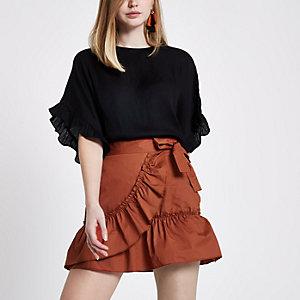 Mini-jupe portefeuille orange rouille en popeline à volants