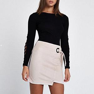 Mini-jupe portefeuille en suédine rose