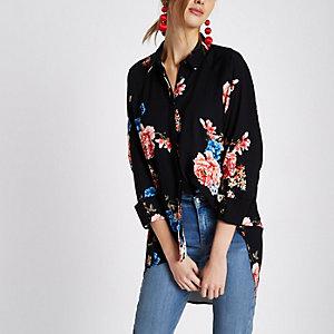 Zwart overhemd met bloemenprint en ongelijke zoom