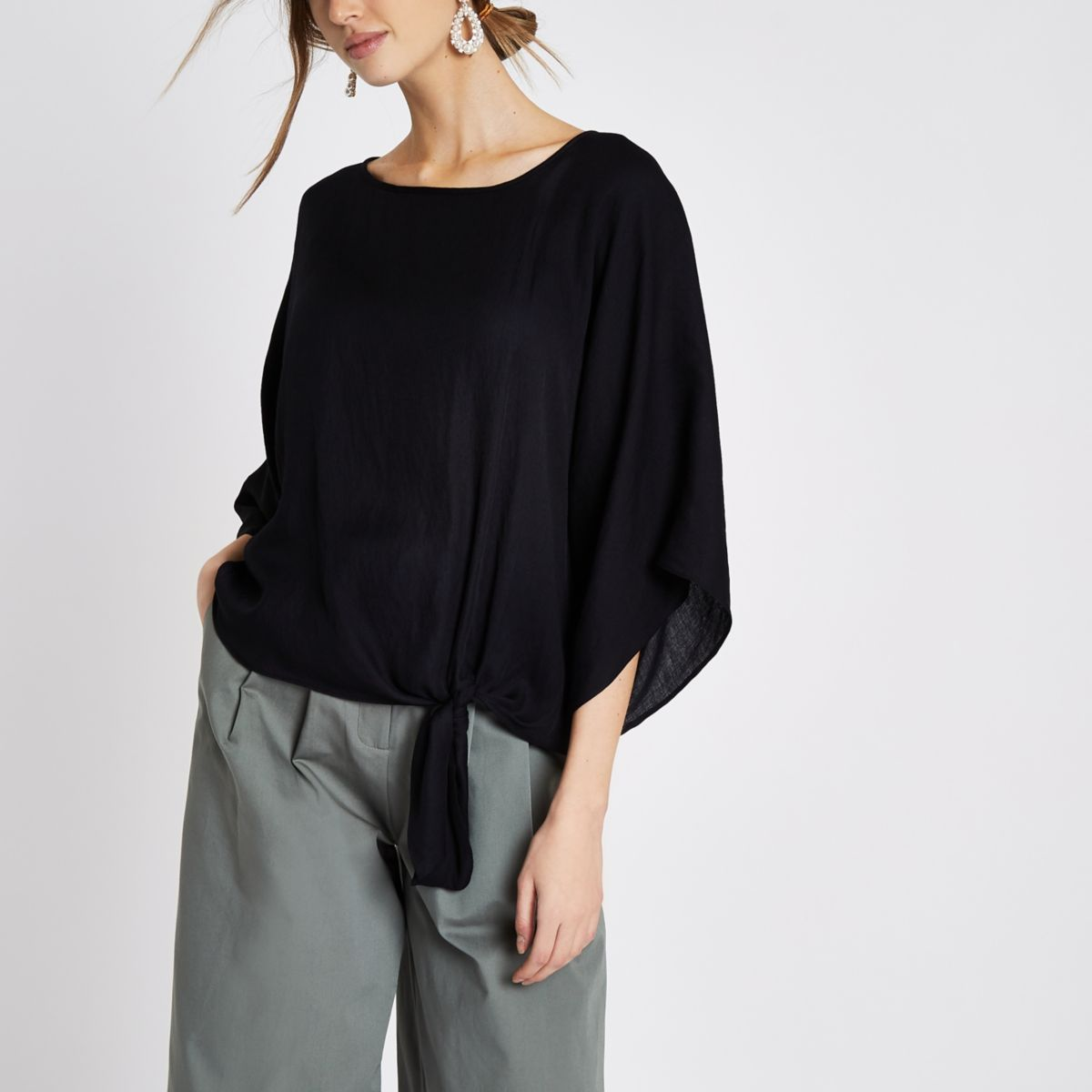 Black loose fit wide sleeve knot hem top