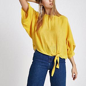 Gele top met knoopeffect opzij en korte mouwen