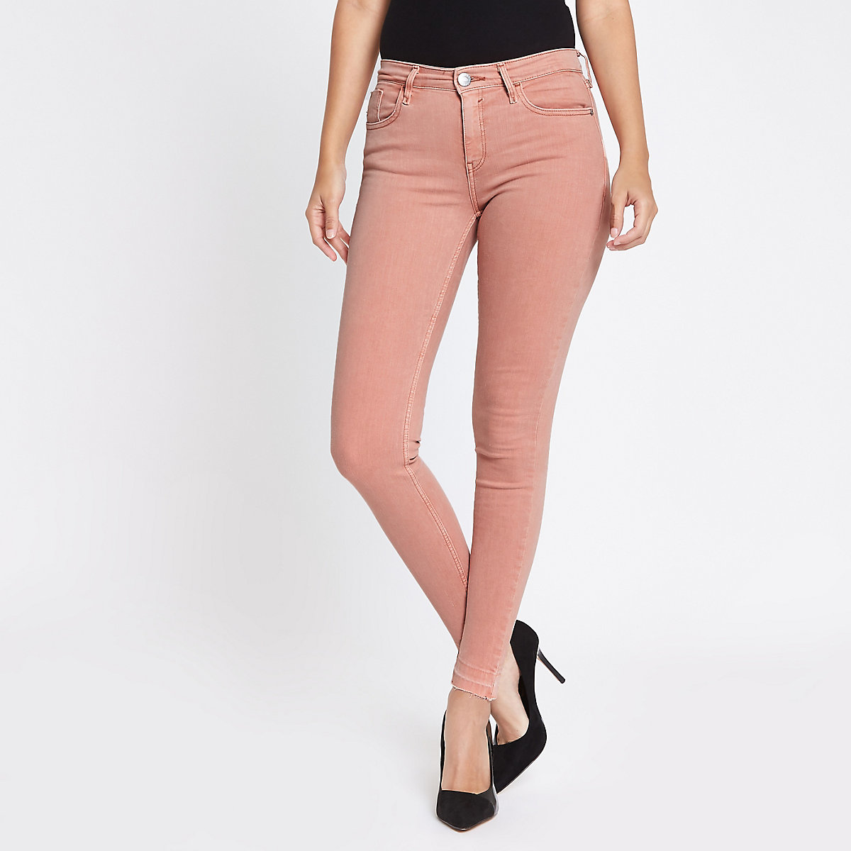 Amelie - Roze superskinny jeans met uitgelegde zoom