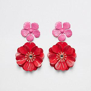 Boucles d'oreilles pendantes rouges motif double fleur