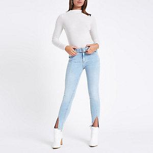 Amelie – Jean skinny bleu à taille standard et ourlets fendus