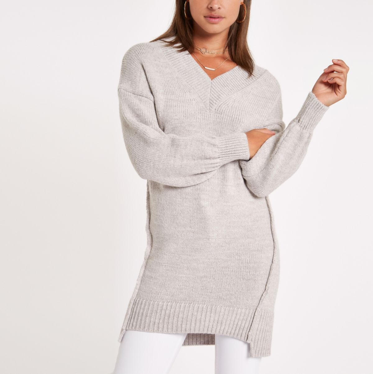 Beige V neck stepped hem sweater