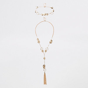 Gold tone hammered disc layered necklace