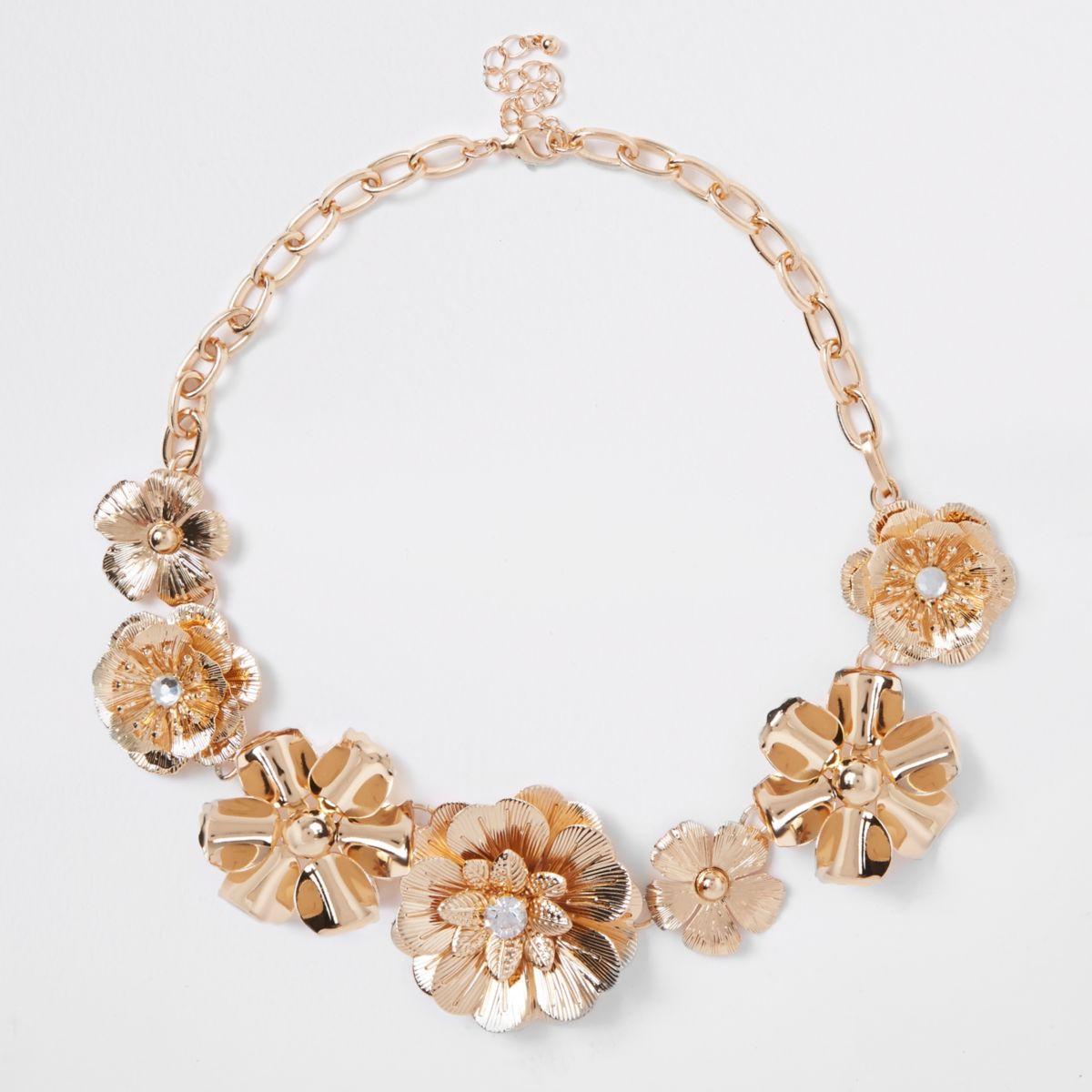 Gold tone flower embellished necklace