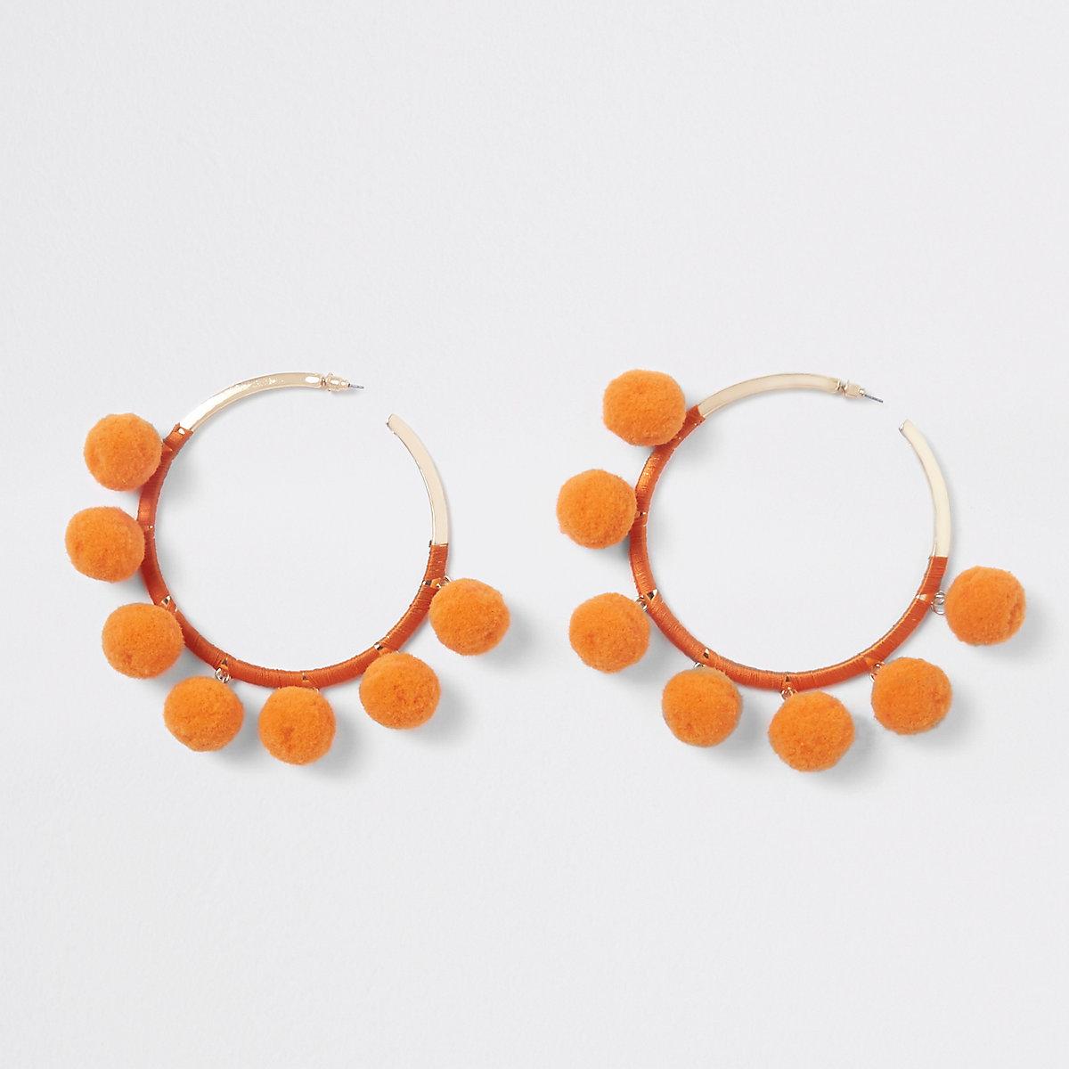 Orange gold tone pom pom hoop earrings