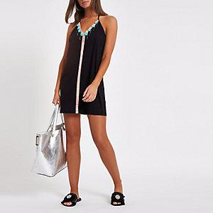 Schwarzes Strandkleid mit Pompon