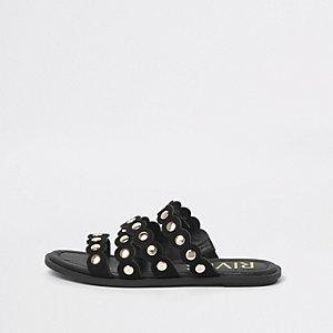 Zwarte geschulpte sandalen met studs