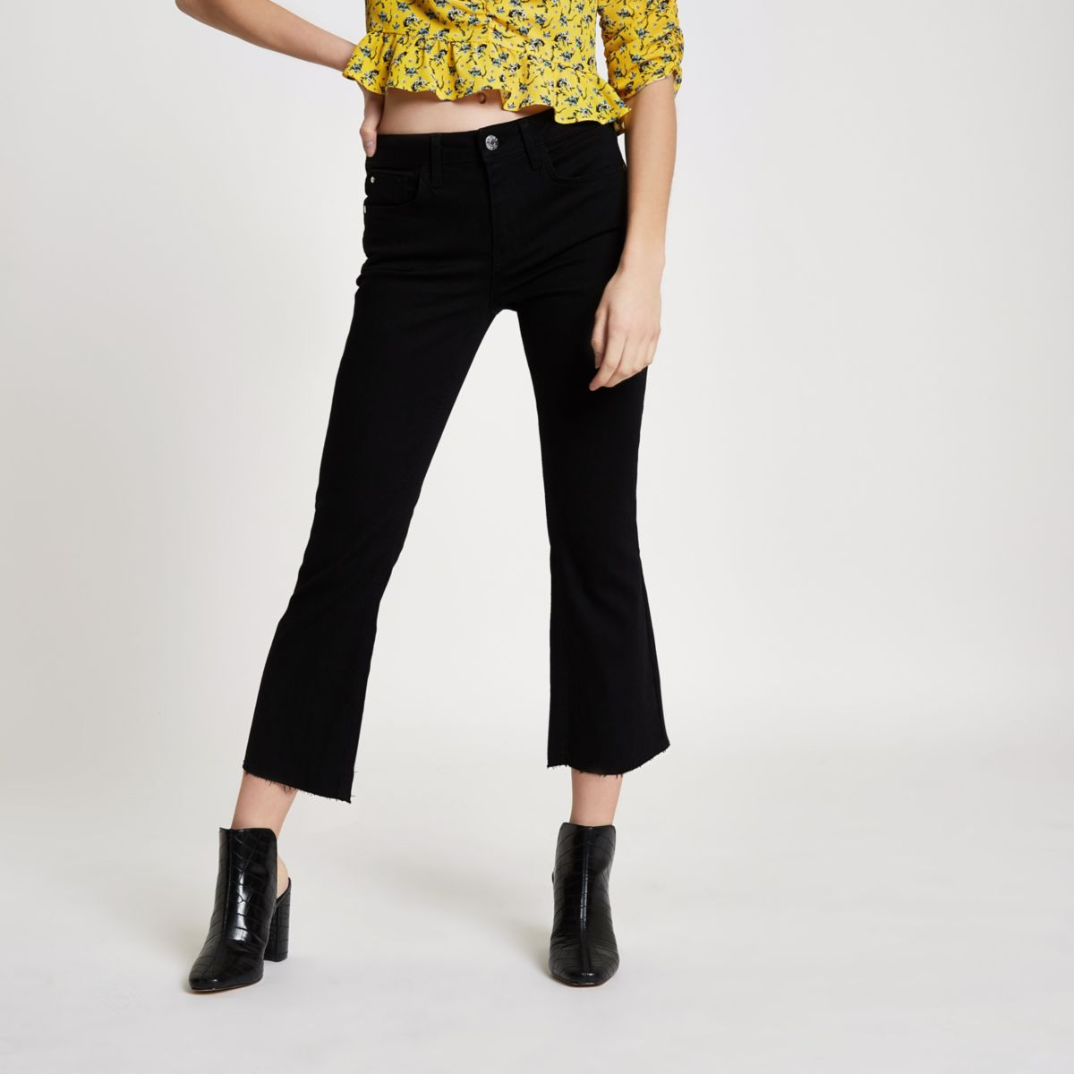 Petite black cropped flared jeans