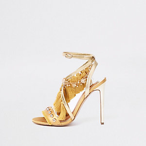 Goudkleurige sandalen met franje kwastje en hoge hak