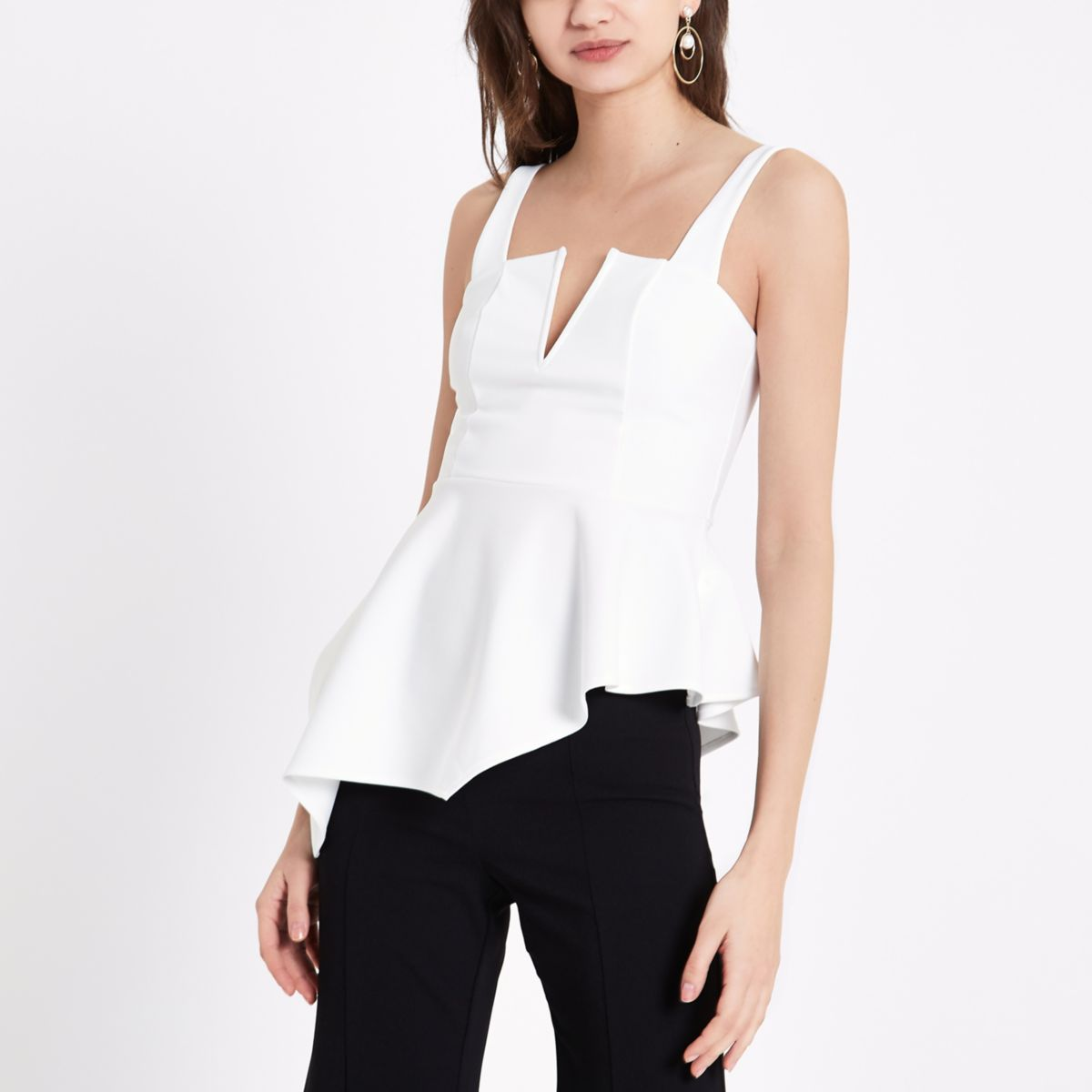 Cream plunge asymmetric peplum hem top