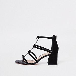 Sandales noires effet cage à strass et talons carrés