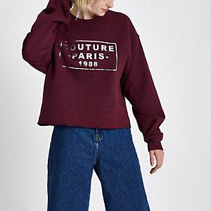 Bordeauxrode sweatshirt met 'Couture'-folieprint