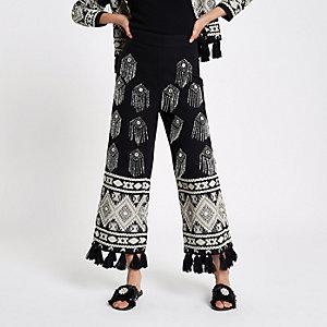 Jupe-culotte noire ornée avec ourlet à pampilles