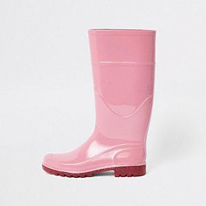 Roze regenlaarzen met glitterzolen