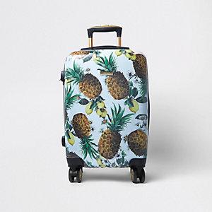 Blauwe plastic koffer met vier wieltjes en ananasprint