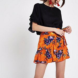 Mini-jupe en jacquard à fleurs orange croisée à volants