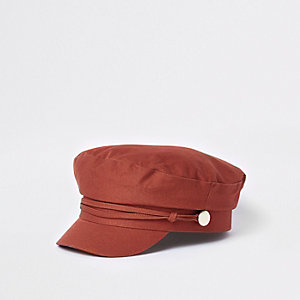 Dark orange studded baker boy hat