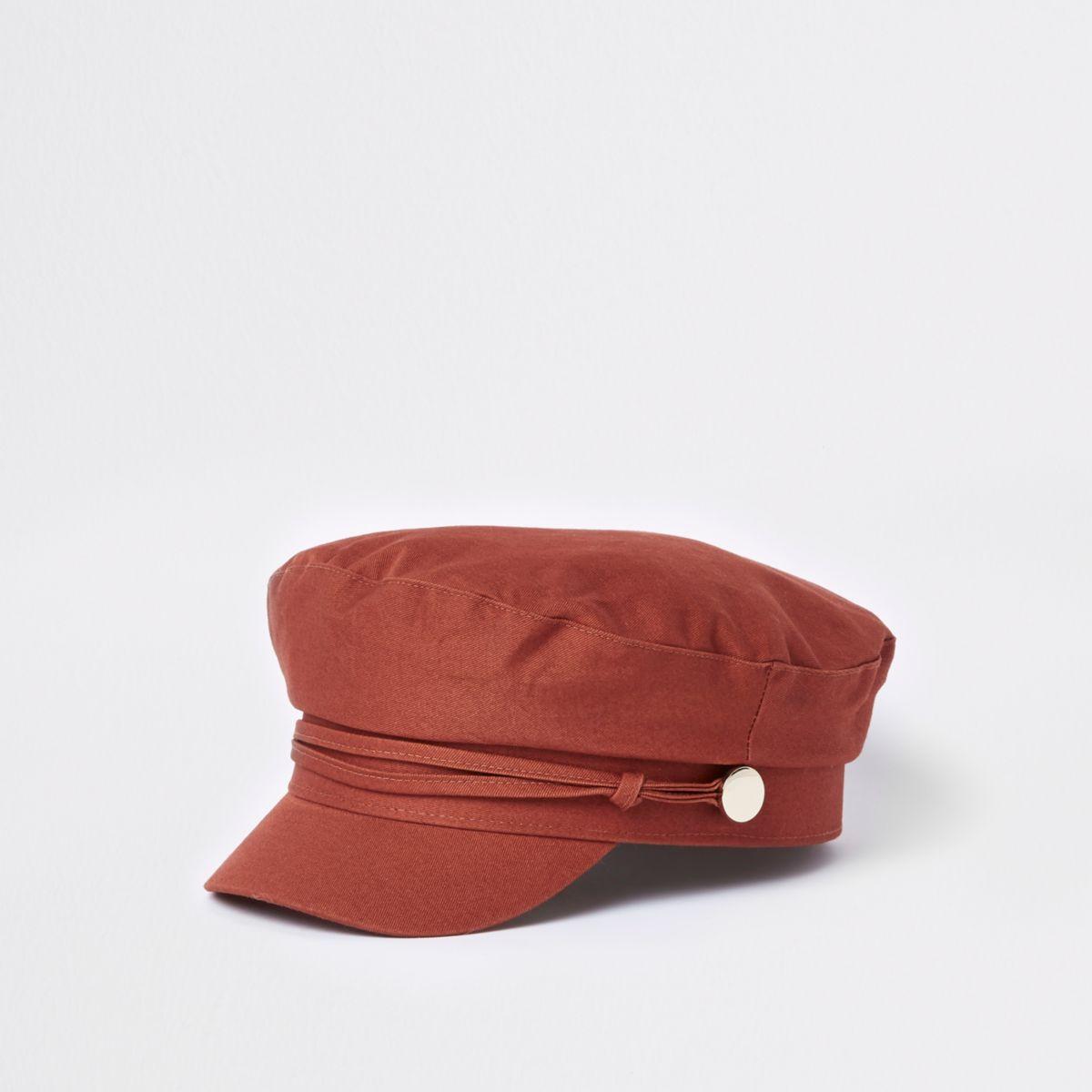 Dark orange studded baker boy hat