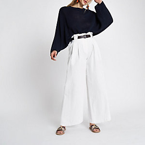 White textured wide leg belted trousers