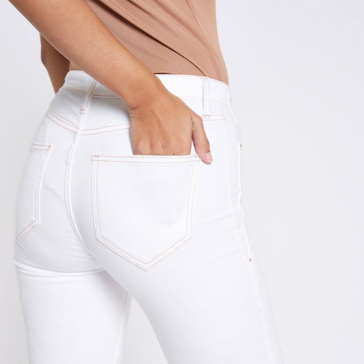 White Harper raw hem super skinny jeans