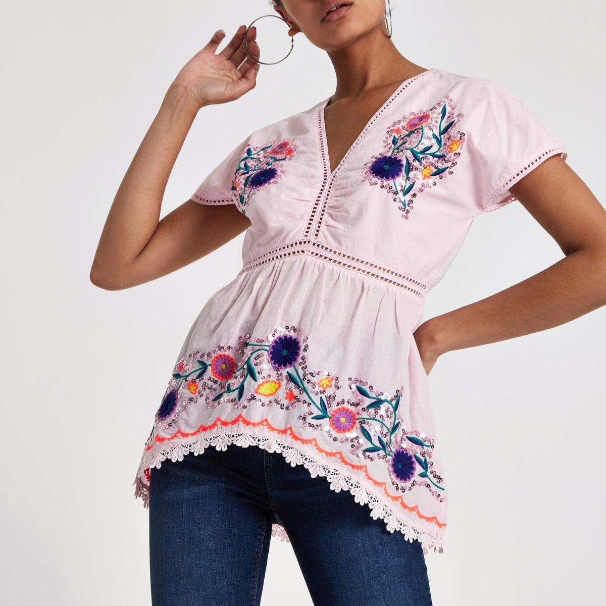 Pink embroidered smock top